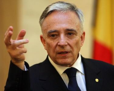 Escrocul naţional de director al Băncii Române, Mugur Isărescu, care arată cu 3 degete cum i-a învăţat pe cei de la cele 3 bănci
